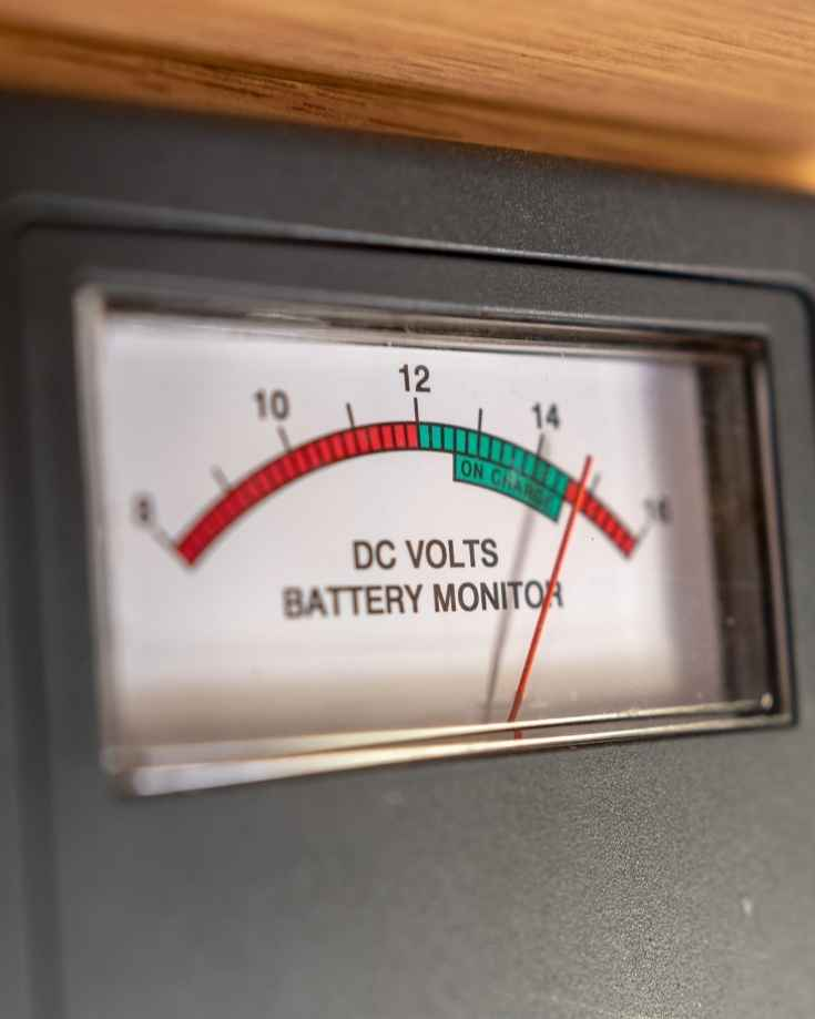 RV battery monitoring gauge reading high DC voltage