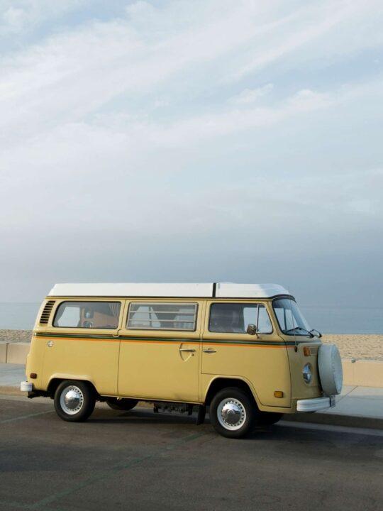 Smal yellow VWl campervan