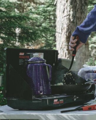 Colemans camping stove is ideal for making coffee in camp and cooking breakfast at the same time