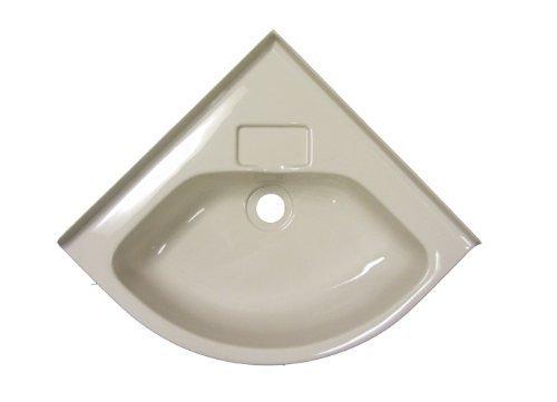 Space saving corner sink for camper bathrooms