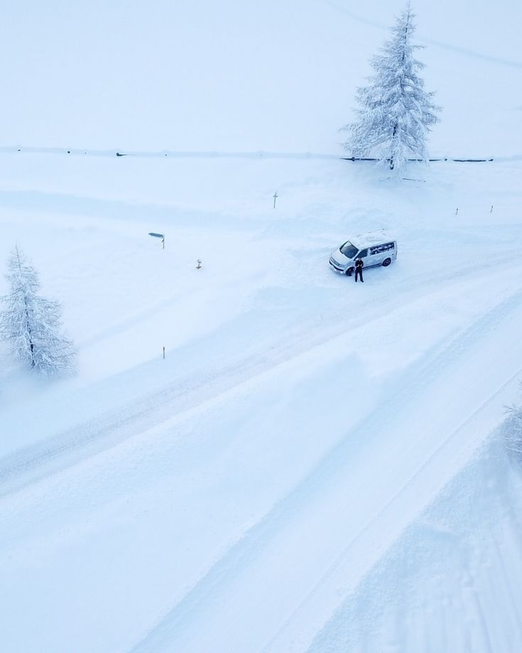 a motorhome in a winter setting with deep snow