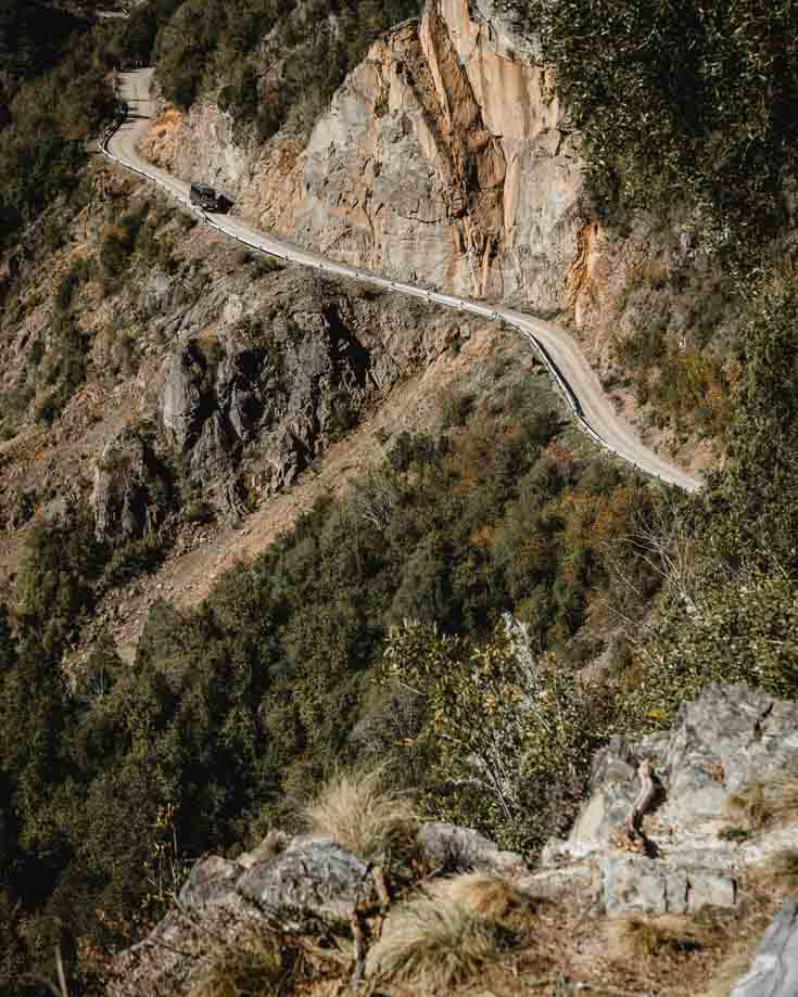Driving a road hugging the mountainside in Patagonia