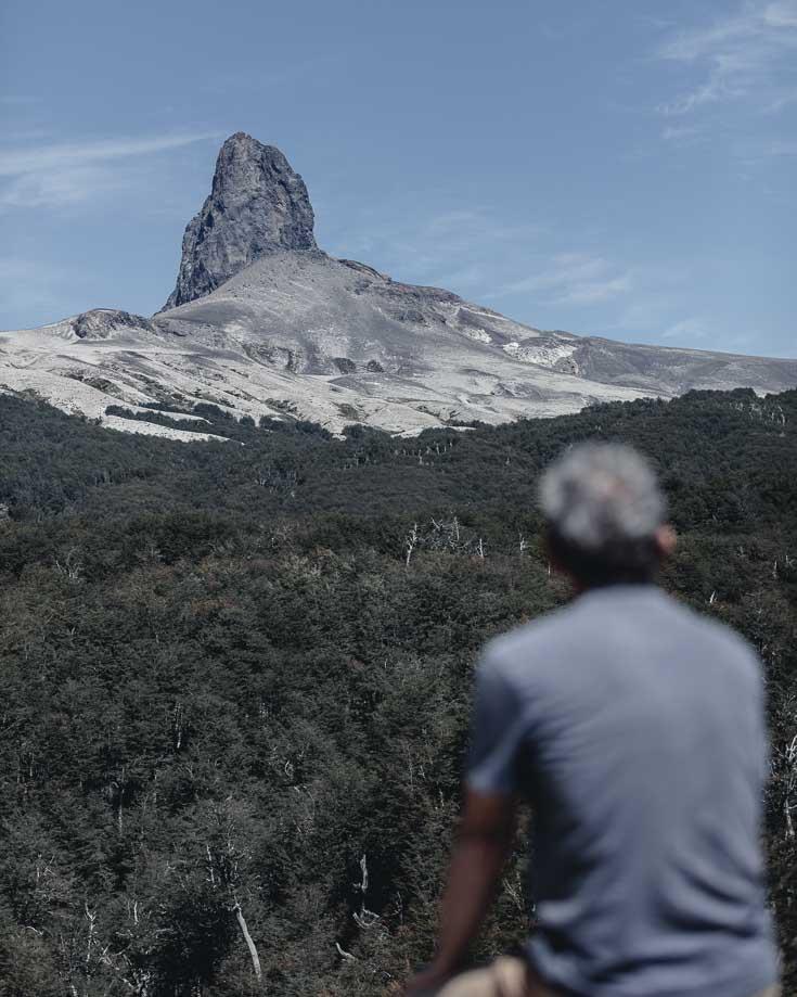 a man enjoying the view of an extinct volcano