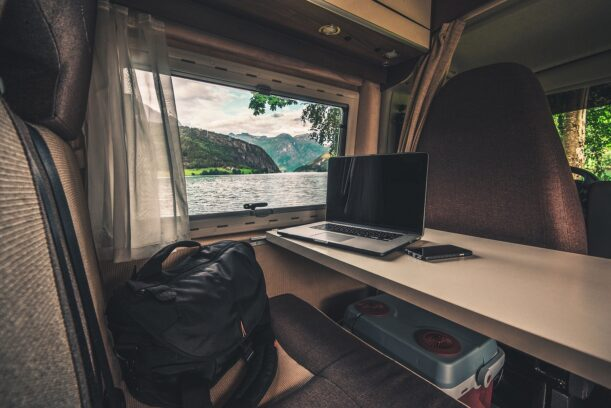 working on computer earning money traveling in a van