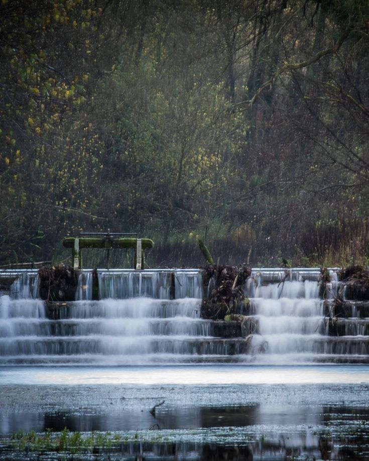 Water falling through the weirs on the River Lathkill, Peak District